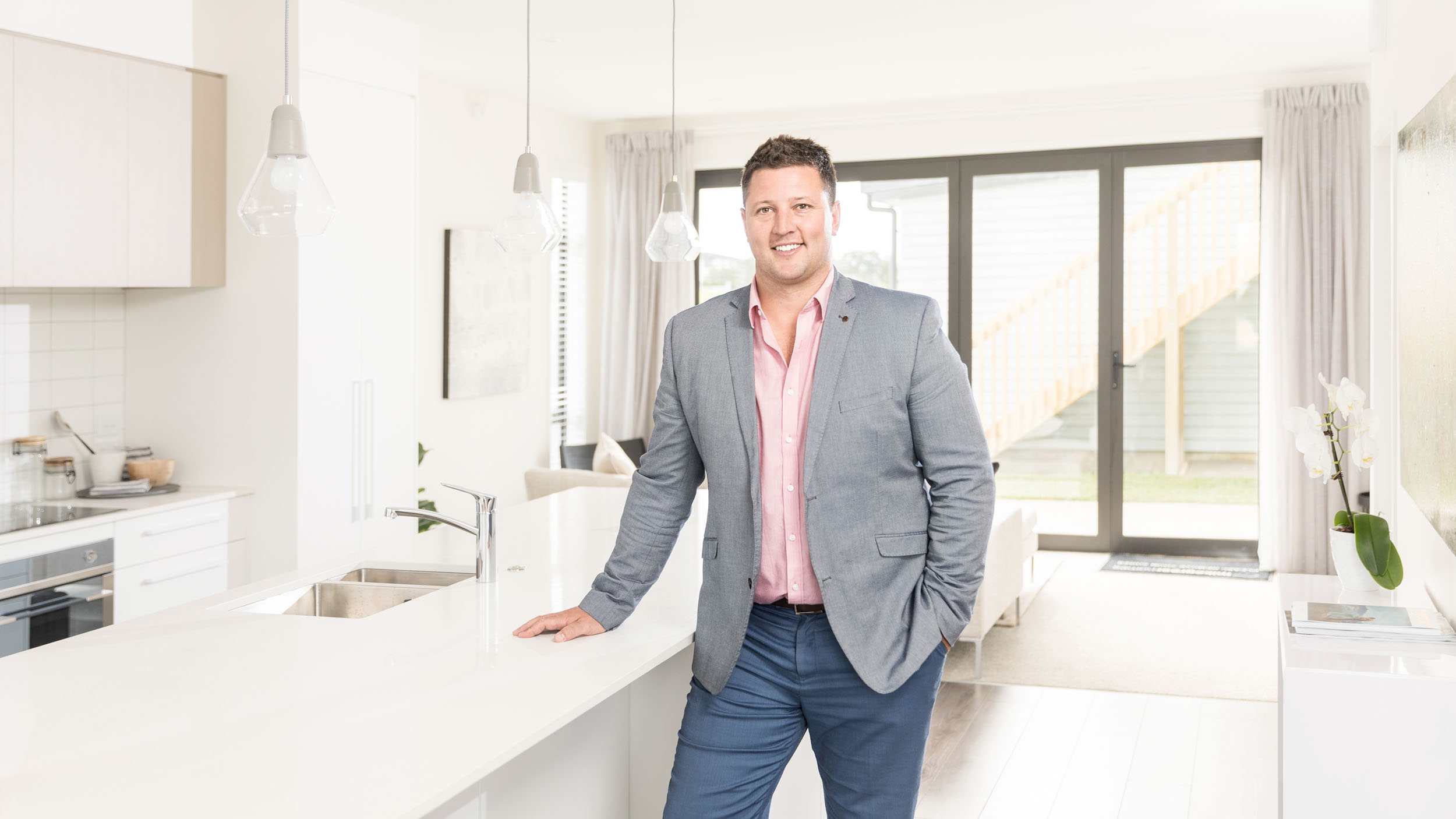 Commercial portrait of a Mike Greer Homes Auckland Salesperson