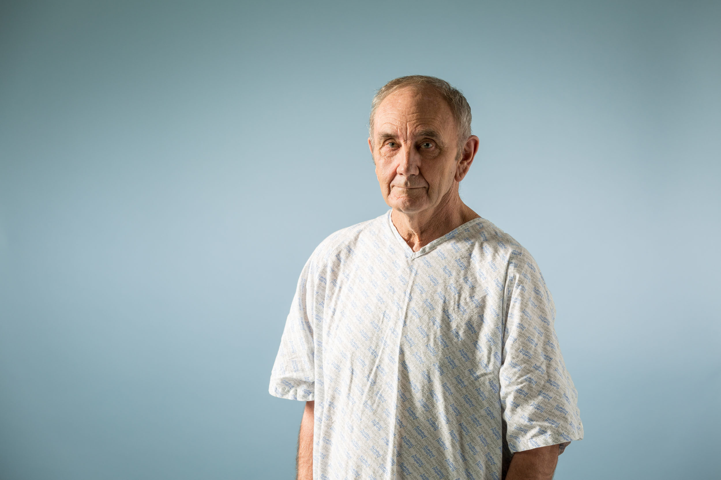 Maia brand photography of a Man in a hospital gown