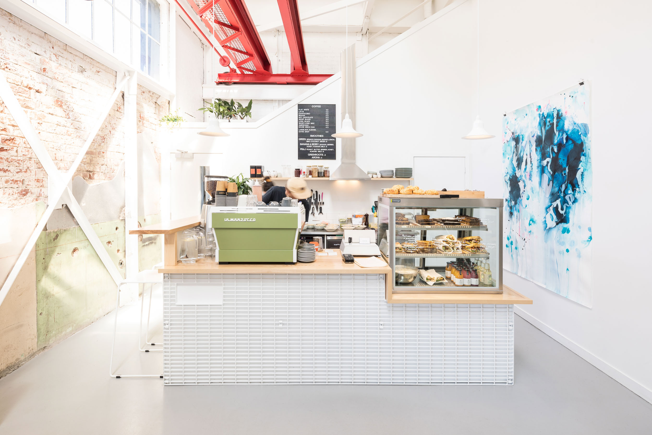 Architecturally designed cafe advertising Qb curated workspaces